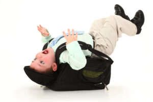 child falling over with back pain from back pack
