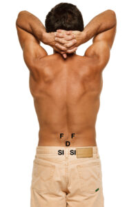 back of man indicating common sources of low back pain